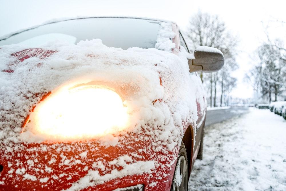 Een houten garage voor auto's – de perfecte winterjas!